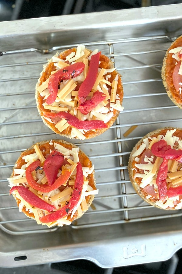 individual pizzas on a baking rack