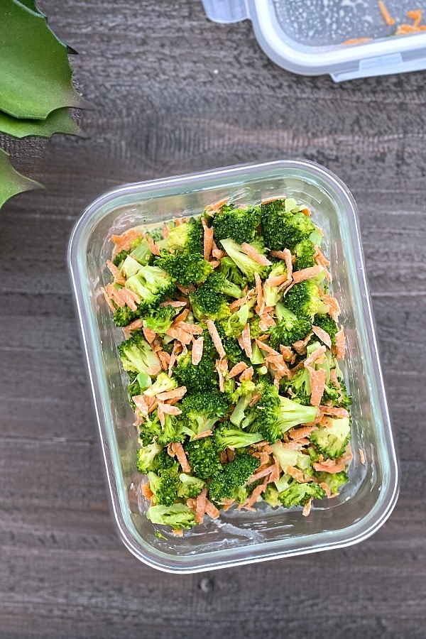 photo of a meal prep broccoli salad recipe in a glass food container