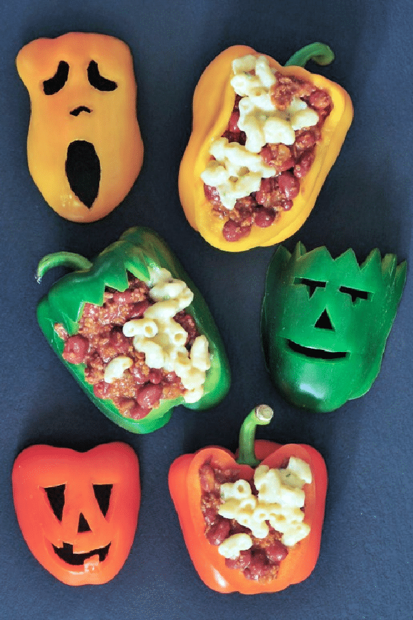 chili mac stuffed bell peppers with Halloween faces carved into the peppers